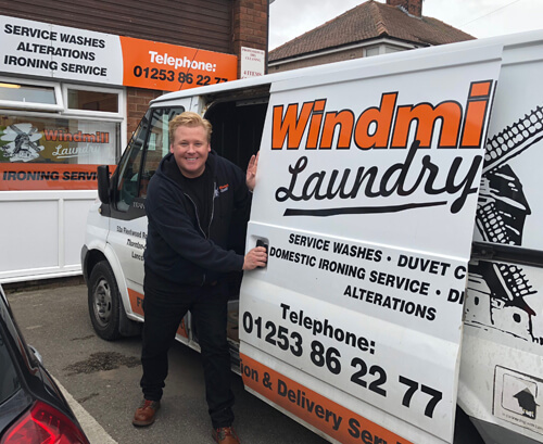 Windmill Laundry Owner with White Van